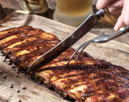 Chef cut up barbecue ribs Stock Photo