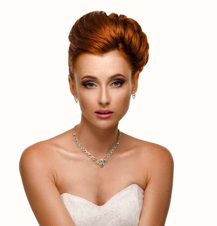 headshoot: Portrait of a beautiful ginger woman in the image of the bride. White background.