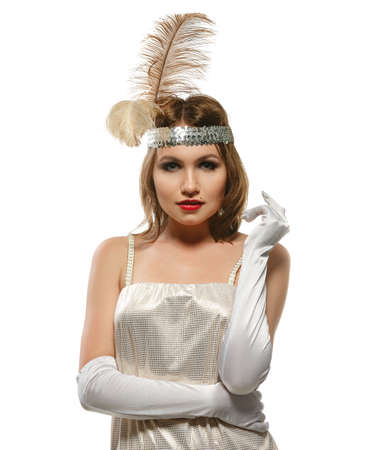 glamour luxury: Elegant woman in the old fashioned white dress with gloves and feather on the head. Retro style. Studio shot on white background. Isolated.