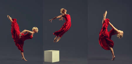 Gorgeous young ballet dancer wearing red dress over dark grey background.