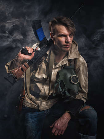 stalker: Armed man with a gun. Post-apocalyptic fiction. Stalker.
