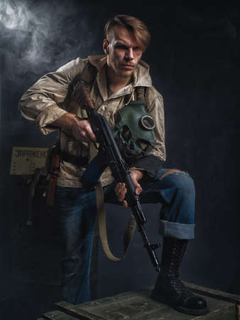 Armed man with a gun. Post-apocalyptic fiction. Stalker.
