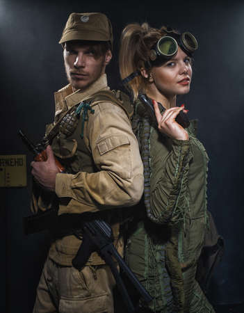 Two Armed men with a weapon. Post-apocalyptic fiction. Stalker. Stock Photo