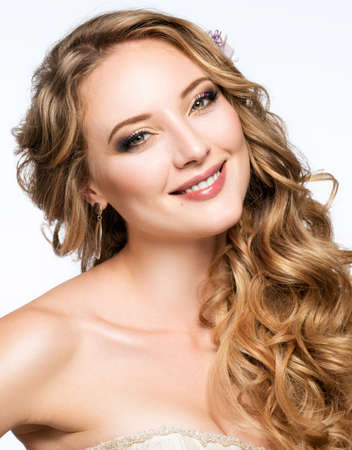 a tooth are beautiful: Portrait of beautiful smiling girl. Wedding hairstyle and make-up.