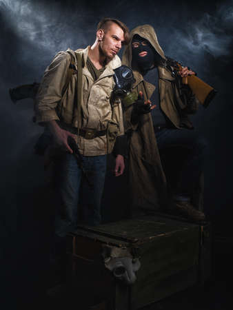 Two armed men. Post-apocalyptic fiction. Stalker. Stock Photo