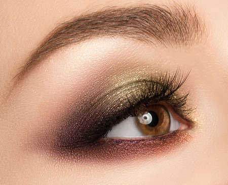ceremonial make up: Eye make-up with bright fashion golden-brown eyeshadow