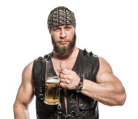the drinker: Beard man drinking beer from a beer mug