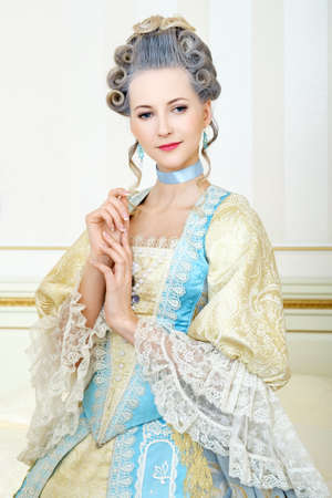 baroque room: Beautiful woman in historical dress in Baroque style in the interior