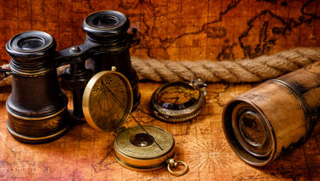 old items: Vintage grunge still life. Antique items on old world map. Travel geography concept.