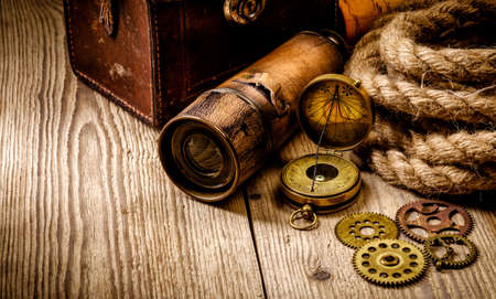 Vintage grunge still life. Antique items on wooden table. Travel geography concept. Stock Photo