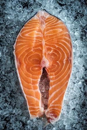 Closeup of Fresh Raw steak salmon on ice. top view.