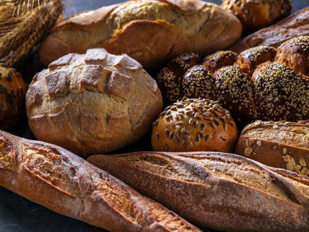 artisan bakery: Different kinds of bread on background Stock Photo