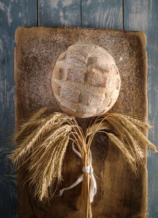 artisan bakery: Round loaf of home made bread on wooden background