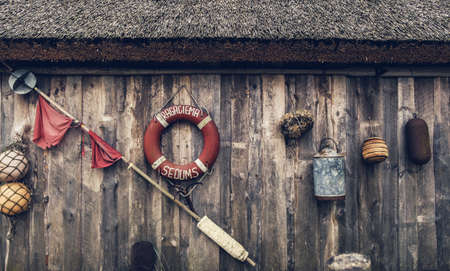 Various fishing tackle on a wooden background