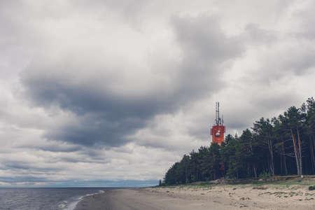 Lighthouse on the seashore. Retro vintage toned image.