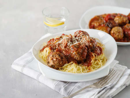 Delicious homemade meat balls in tomato sauce with spaghetti