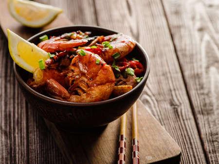 Large grilled BBQ shrimp with sweet chili sauce, green onion and lemon