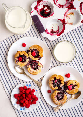 Tasty fresh homemade puff pastry with berries on the white wooden table. 스톡 콘텐츠