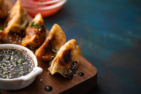Fried Chinese dumpling called Gyoza, kind of asian food. Stock Photo