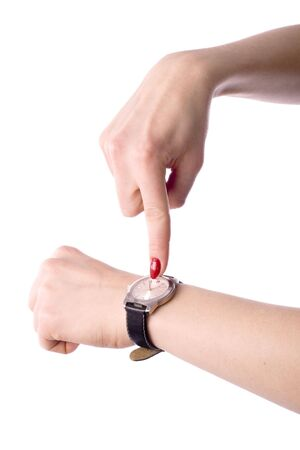 womans: womans hand with clock over white