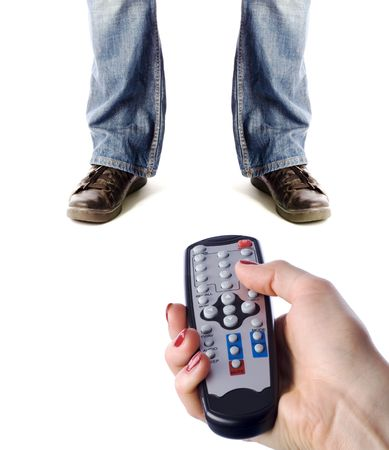 subordinated: woman controls the man with remote control over white Stock Photo