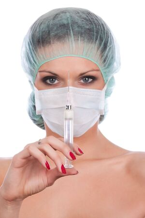 surgical mask: Beautiful young doctor  Stock Photo