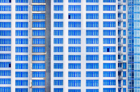 Photo of a facade of a multi-storey building with identical windows Stok Fotoğraf