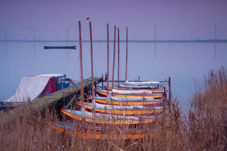 recreation sailing boats on lake at sunset
