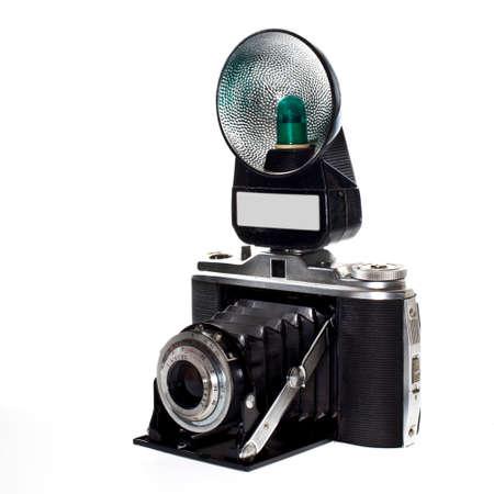 historic photocamera with flash isolated on white background