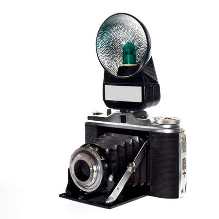historic photocamera with flash isolated on white background