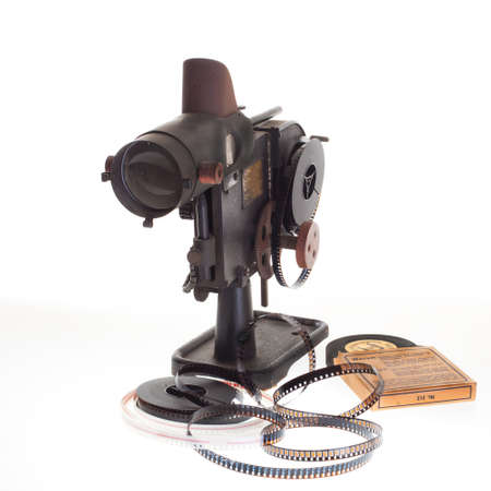 16mm: old vintage home filmprojector on white background Stock Photo