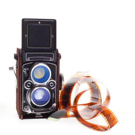 historic vintage camera with negatives in color on white background Stock Photo