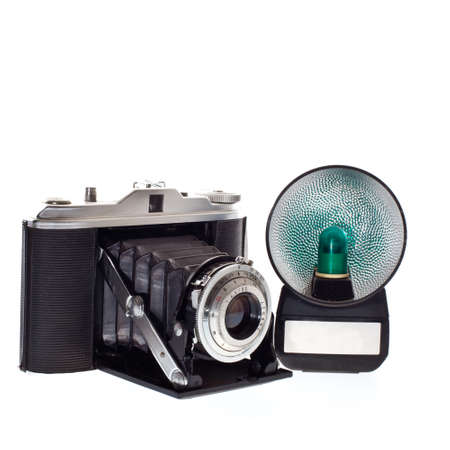 old vintage camera with flash on white background