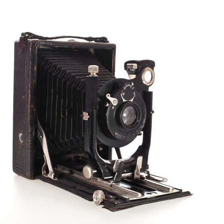historic old photo camera isolated on white background