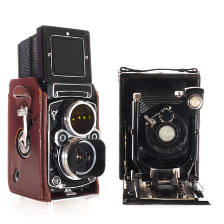 Twoo types of historic photo cameras isolated on white background photo