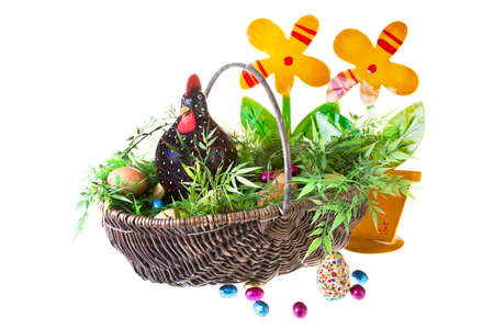 easter chicken with eggs in a basked on white background Stock Photo