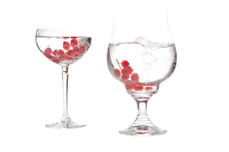 bowl of fresh fruit in sparkling water on white background