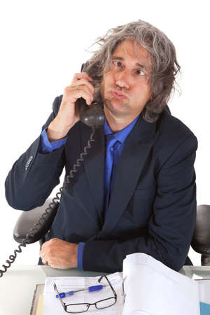 exerted: Senior  buisinessman getting crazy at the phone