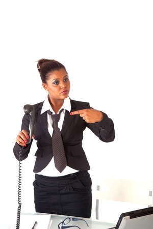 secretary asks her manager to come on the phone Stock Photo