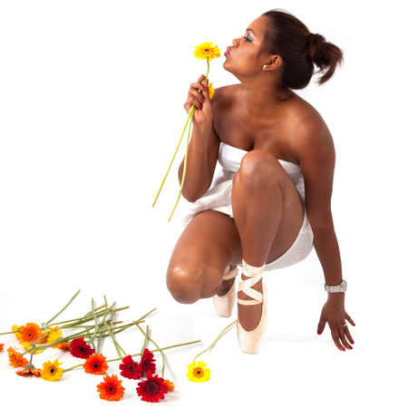 ballerina gives performance by kissing yellow flowers  photo