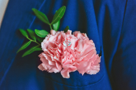 boutonniere: Pink boutonniere with blue costume groom. Stock Photo