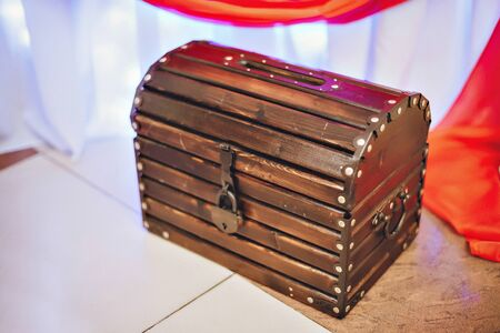 numismatist: old wood and metal chest Stock Photo