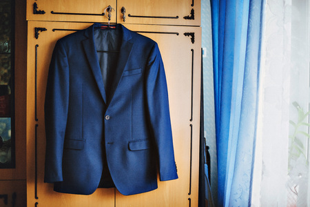 without clothes: Dark blue in a small checkered formal men suit jacket