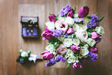 Purple pink white wedding bouquet of flowers gold rings lay purple pink white wedding bouquet of flowers gold rings lay in a wooden mightylinksfo