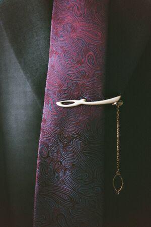 tux: purple satin tie with black tux. Closeup.