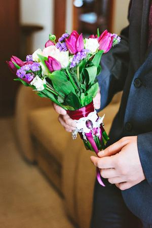 Purple pink white wedding bouquet of flowers in the hands of purple pink white wedding bouquet of flowers in the hands of men stock photo mightylinksfo