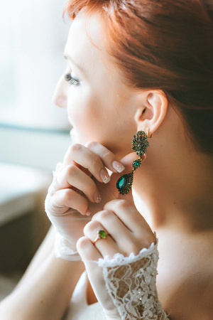 earings: Earrings with green gemstone. Beautiful jewelry. Aged gold