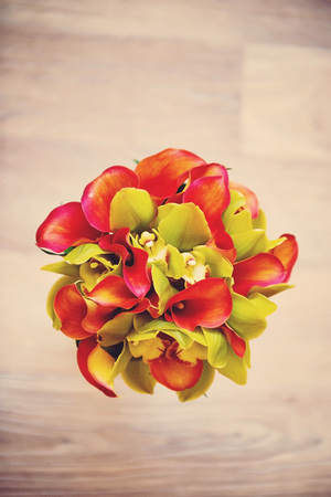 Wedding bouquet of orange Calla lilies. The view from the top