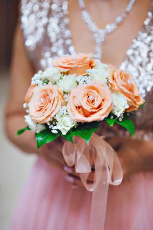arm bouquet: Wedding pink bouquet in hands of bride.