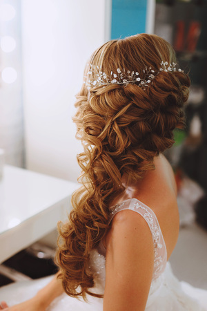 The decoration of the bride. Braided silver hair ornament in an elegant wedding the brides hairstyle